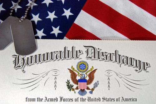 A US Armed Forces honorable discharge form with an American flag and pair of dog tags.